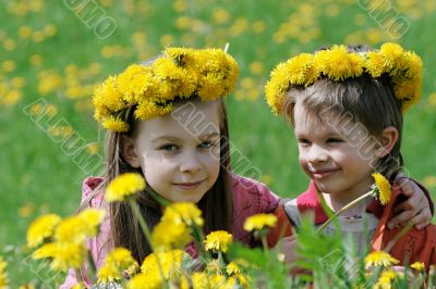 Brother and sister with dandelion garlands