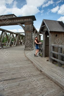 Beauty girl on old-time bridge.