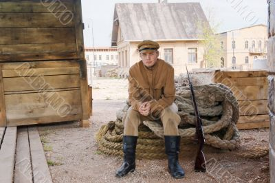 Retro style picture with soldier sitting on rope