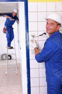 duo of electricians indoors