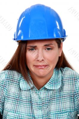 A crying female construction worker.
