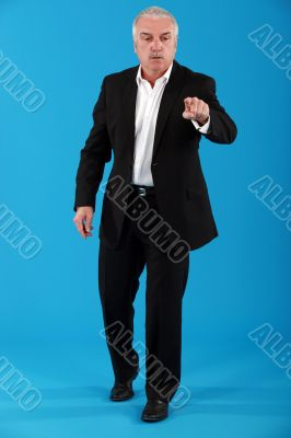 mature businessman pressing button