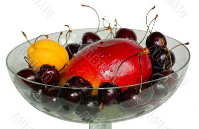 Fruit in vase isolated on white background