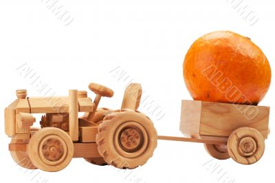 Toy tractor with orange pumpkin.