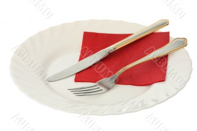 Fork and knife on a plate