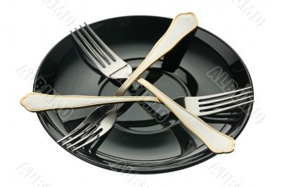 Three forks on a plate