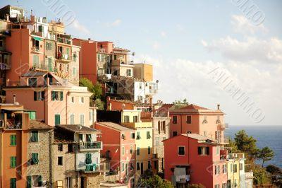 pink,orange,yellow houses