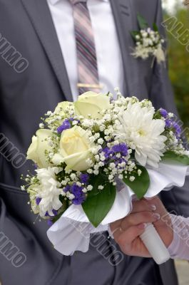 Wedding bouquet in a hand of the bride