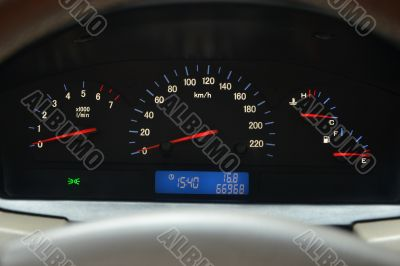 speedometer and a tachometer, level of fuel and temperature