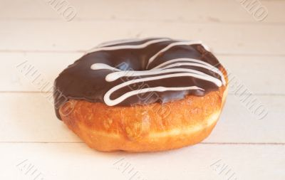 Donut covered in chocolate icing and sprinkles