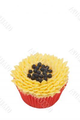 Vanilla cupcake with sunflower decoration