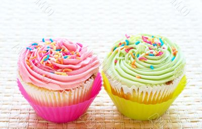 Vanilla cupcakes with strawberry and lime icing