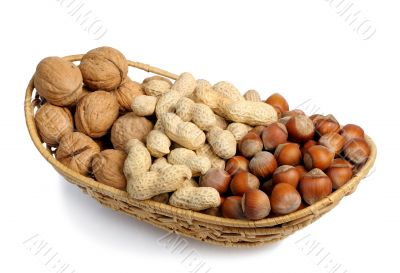 Set of nuts in a wicker basket, isolation
