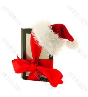 Electronic book reader wearing Santa`s hat
