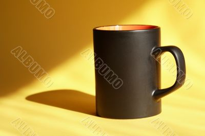 Black Mug On Yellow