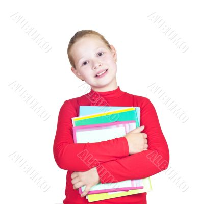 child with a stack of notebooks