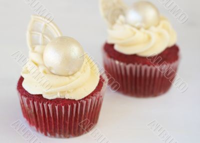 Red velvet cupcakes with icing and decorations