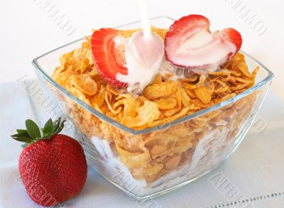Bowl of breakfast cornflakes with strawberries