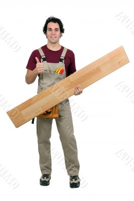Handyman carrying plank on white background