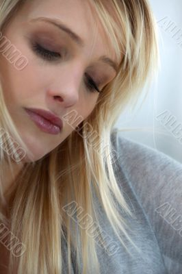 Blond woman looking sad