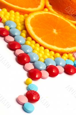 The different color vitamins with orange DOF