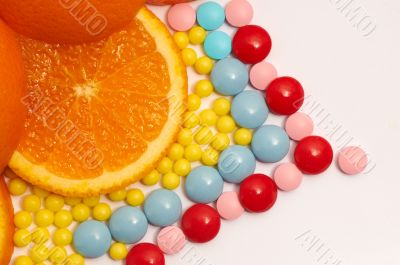 The different color vitamins with orange