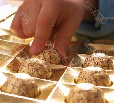 Children's hands taking chocolate