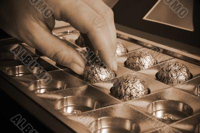 Woman's hand taking chocolate
