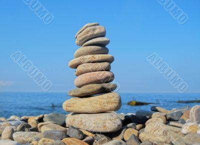 Balanced stones on the seashore summertime