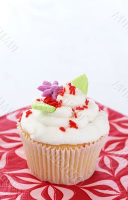Vanilla cupcake with flower decorations