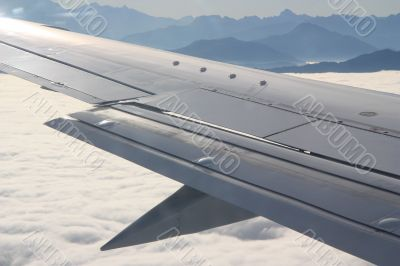 Above the clouds and mountains