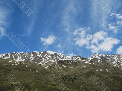 Caucasus mountains under the snow and cloudy sky