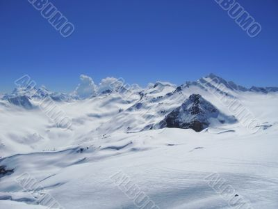 Caucasus mountains under the snow and clear sky