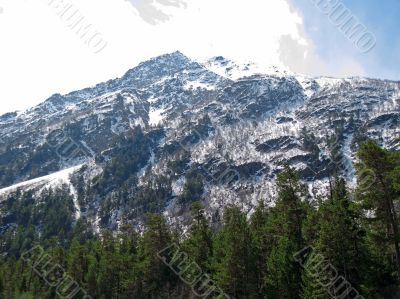 Caucasus mountains under the snow and cloudly sky