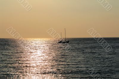 Seascape with calm water and sailboat