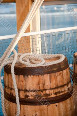 Barrel and rope on sea background