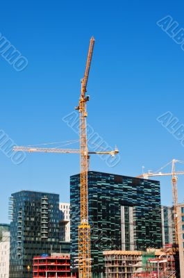 Buildings with two tower cranes