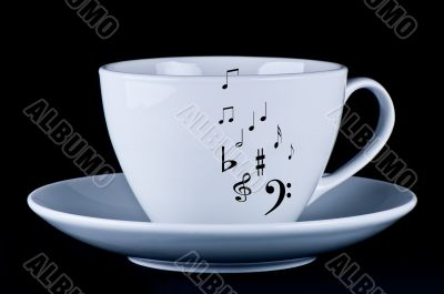 White cup with black musical notes