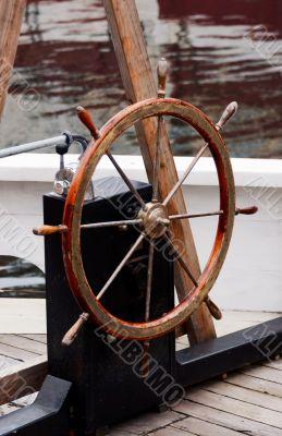 Wooden steering wheel on old sailboat