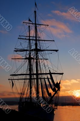 Tall ship silhouette at sunset