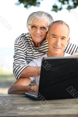 Retired couple on the computer