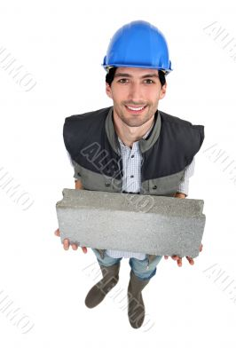 Builder with a block in his hands