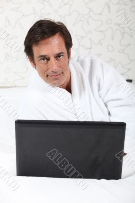Man working in dressing gown.