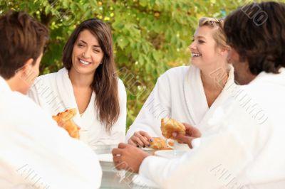 Four friends sharing breakfast