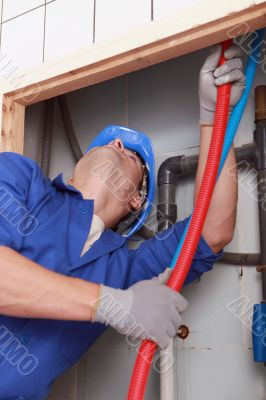Skilled technician repairing canalizations