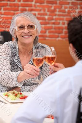 senior woman having lunch in a restaurant