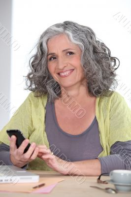 Older woman using a cellphone