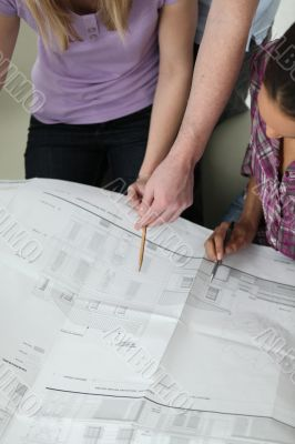 Coworkers discussing architectural plans