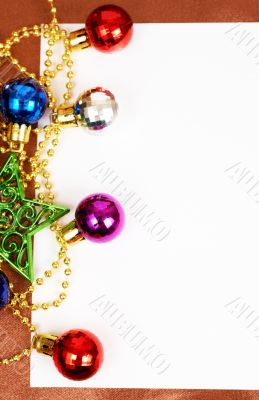 Colorful Christmas baubles and card
