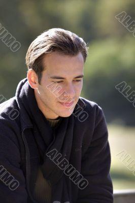 young man relaxing outdoors